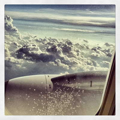 airplane window clouds