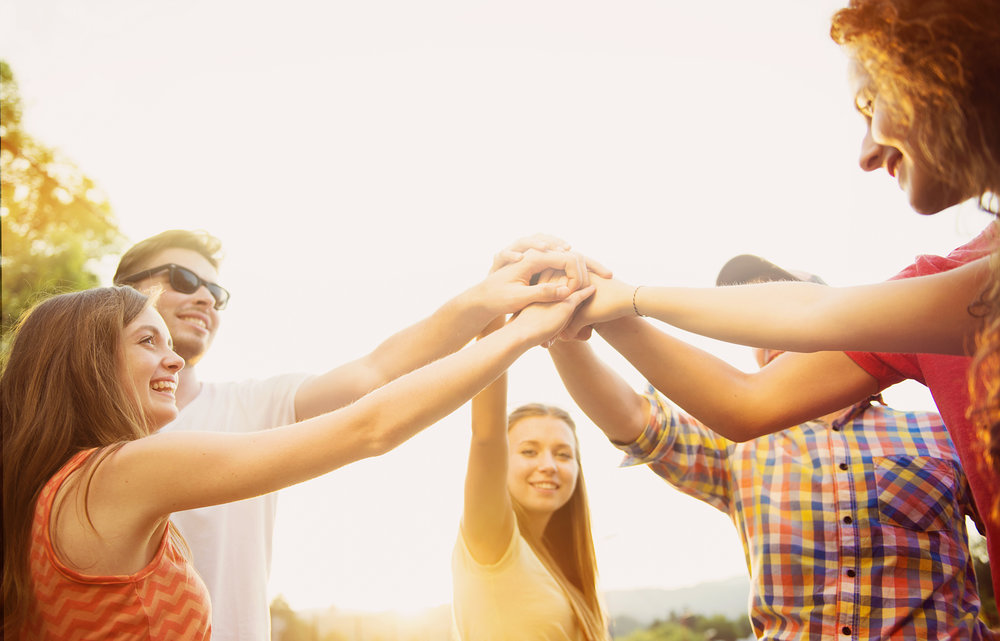 graphicstock-group-of-young-people-with-hands-in-stack_rCABv7n--.jpg