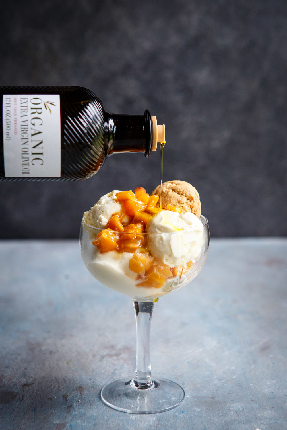 In partnership with Carapelli® Organic Extra Virgin Olive Oil |   No Churn Olive Oil Ice Cream with Roasted Peaches