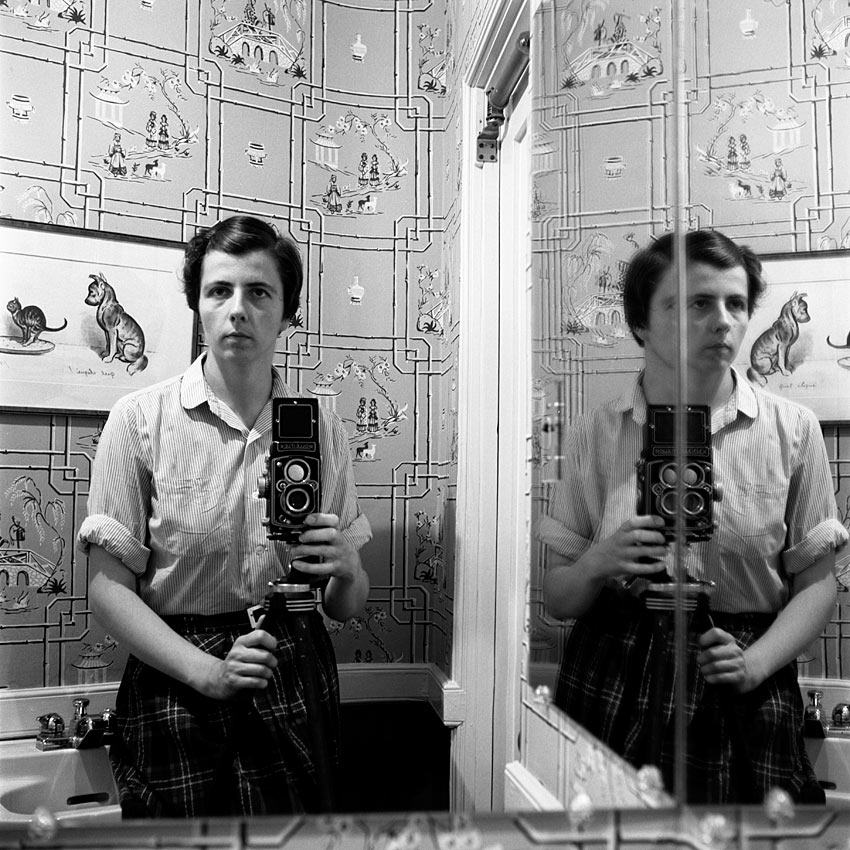 Vivian Maier having loads of fun in the bathroom
