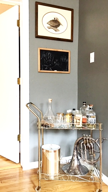 Like this chalkboard and fancy bar cart with a casual French horn.  Bar cart is from an antique store in Milwaukee.