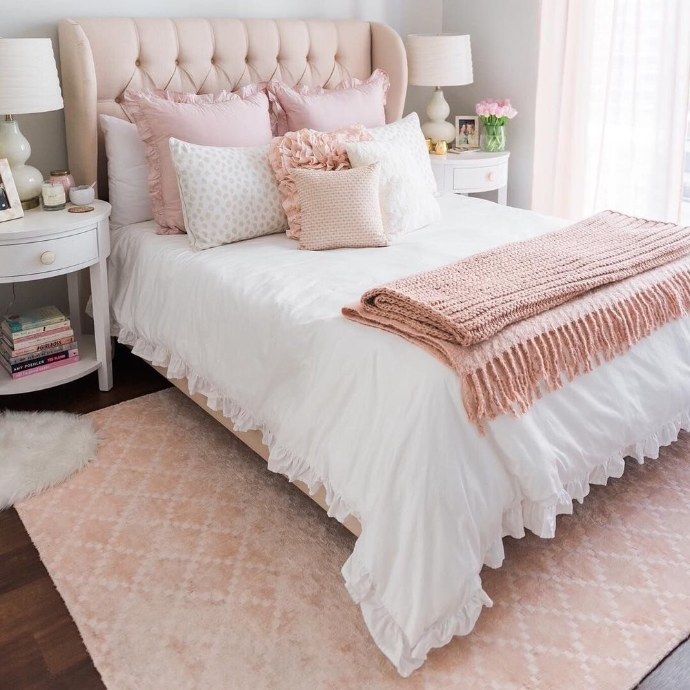Textiles - Crushed, stonewashed nude linens are to die for but an entirely pink duvet can be quite overbearing. A soft blush throw draped over a sofa, bed, or chair will add a beautiful touch of pink to any room. We also recommend mixing and matching some pink pillows with white or grey linens.