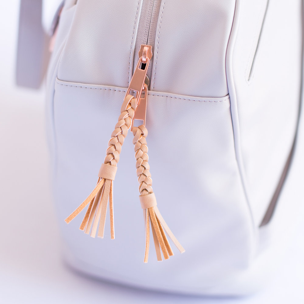 All in the details: Rose gold hardware, braided zipper pulls, and metallic foil logos.