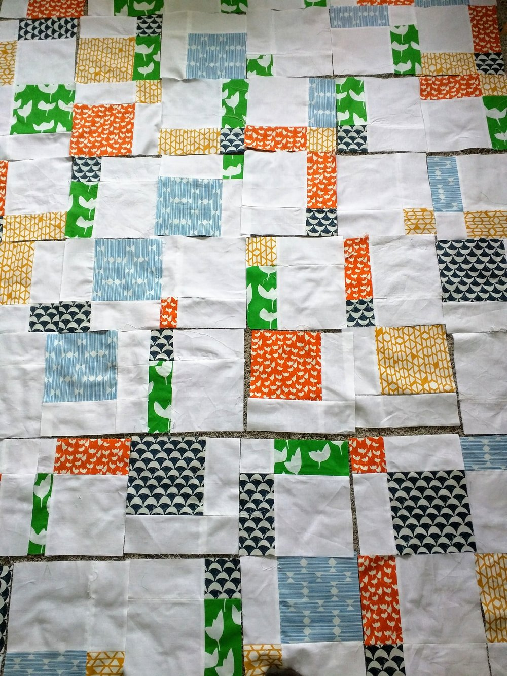 A wedding quilt in progress for our friends Anne and Andrew. This piece was made using the Disappearing Modern Nine Patch method. I love how it plays with negative space, balancing some truly bold patterns and saturated colours with lots of stark white.