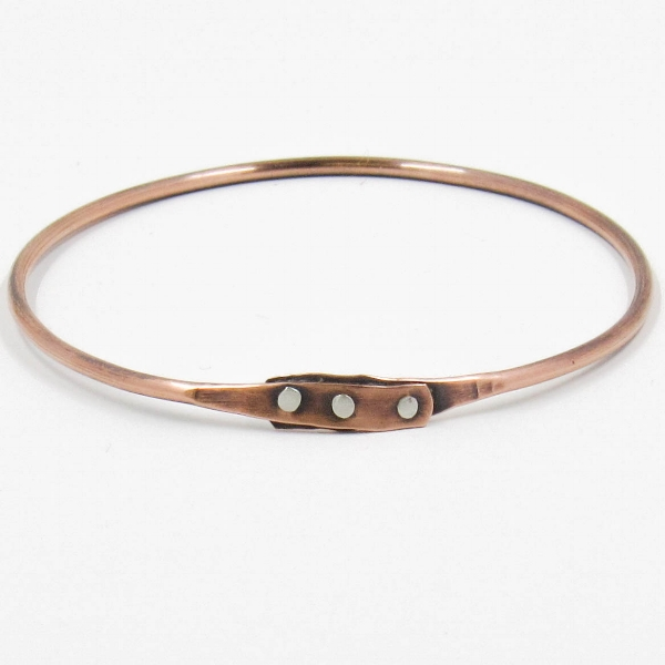 Copper bracelet with silver rivets by Riin Gill Design