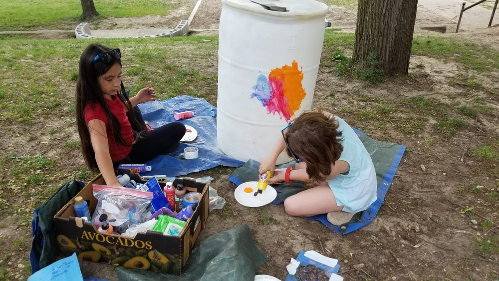 North Park Montessori Students Painting Rainbarrels at Workshop