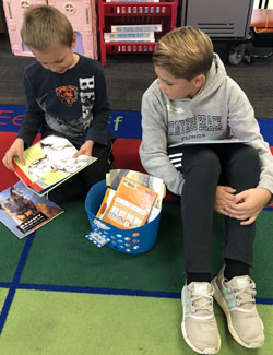 Dylan listens to his Grandville partner read during a visit to Central Elementary
