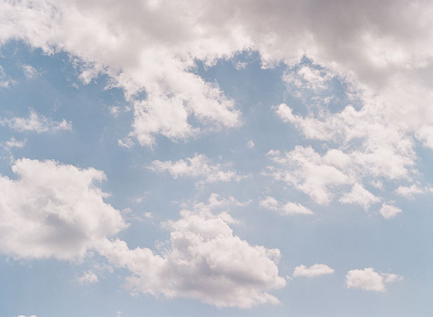 a beautiful blue sky with fluffy white clouds.