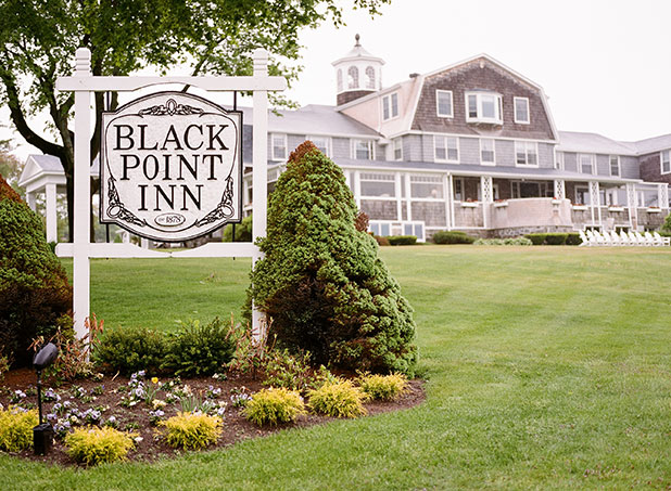 Coastal New England photo of The Black Point Inn in Scarborough, Maine, the exterior of the inn and the welcome sign at the entrance.