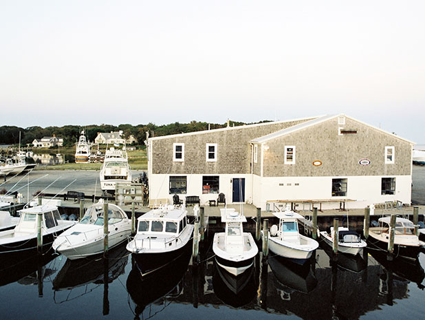 Boats docked at sunset shot from the outdoor patio at Wychmere Resort on Cape Cod.