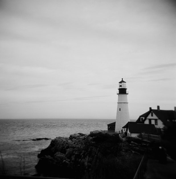 Film photo of a lighthouse, shot on a holga with black and white film, in Maine.
