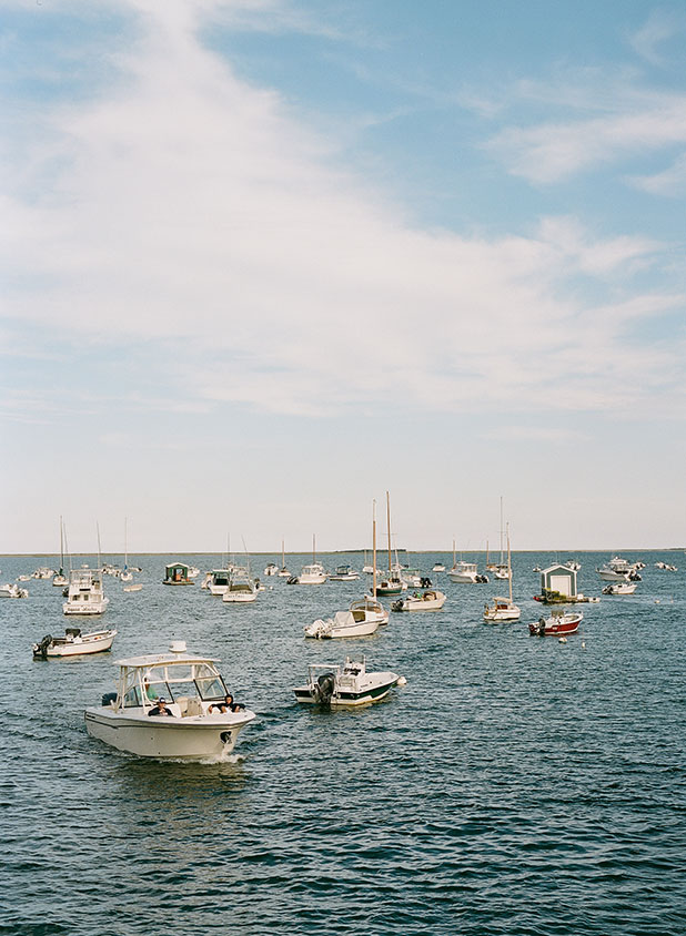 An image of boats floating on the water in coastal New England shot from the Maritime school in Duxbury, Massachusettes.