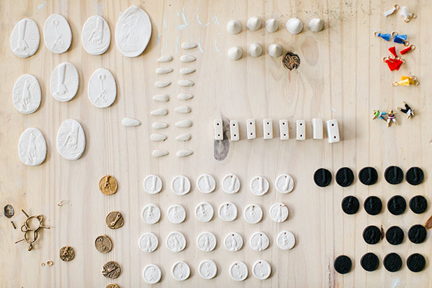 in process shot of porcelain jewelry and leather details - Sarah Der