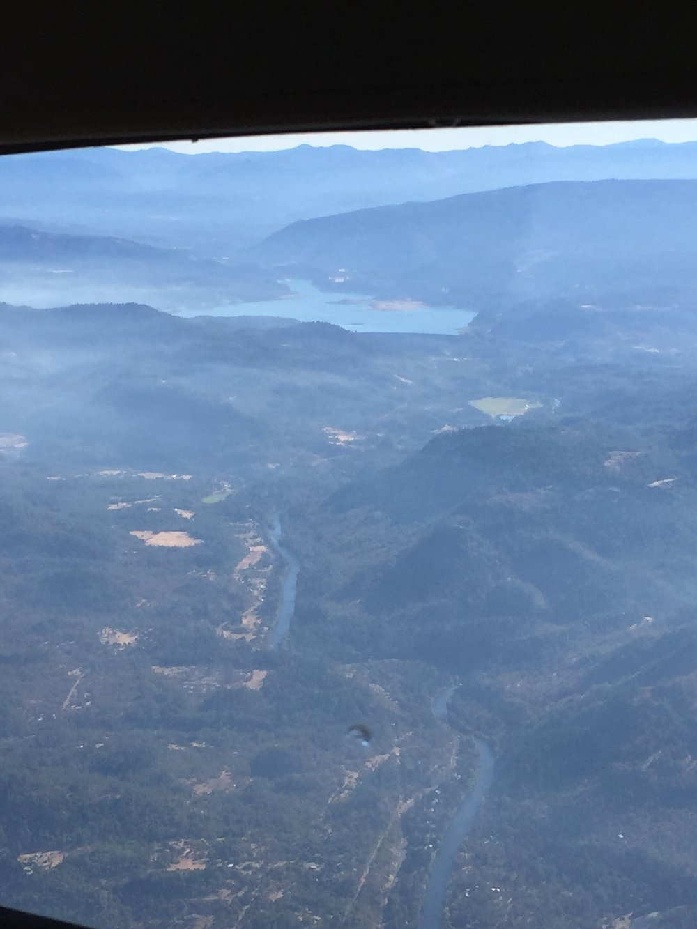 A view of Lost Creek Lake and the Rogue River near the proposed Pacific Connector Pipeline crossing around 2 miles upstream from Shady Cove, Oregon. Smoke from the Miles fire clouds the image.