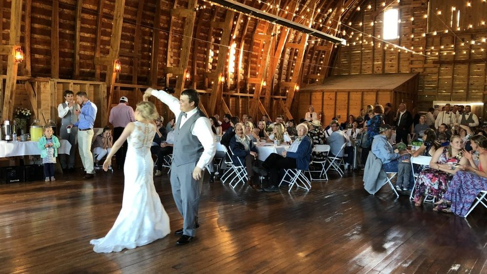 Dale and Lindsay Hubbert taking a twirl during their first dance at their wedding reception in the Yellow Barn, a spectacular events venue near Belgrade, Montana on Saturday.