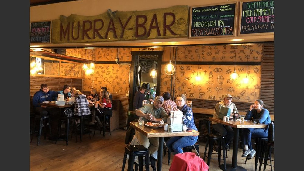 The Murray Bar features Montana cattle brands. My father's brand during his days on a homestead near the Terry Badlands in 1930s & 40s was a horizontal Y with a 5 at the end of the Y (known as Lazy Y Bar 5).