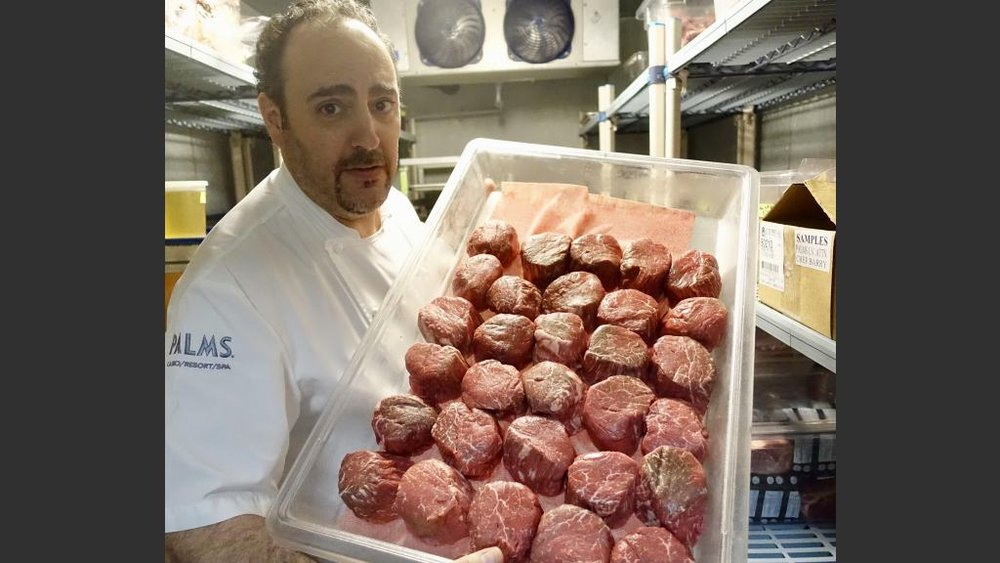 Chef Barry Dakake with ready-for-grilling filet mignon.