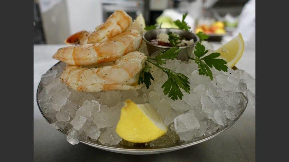 Shrimp cocktail on ice.