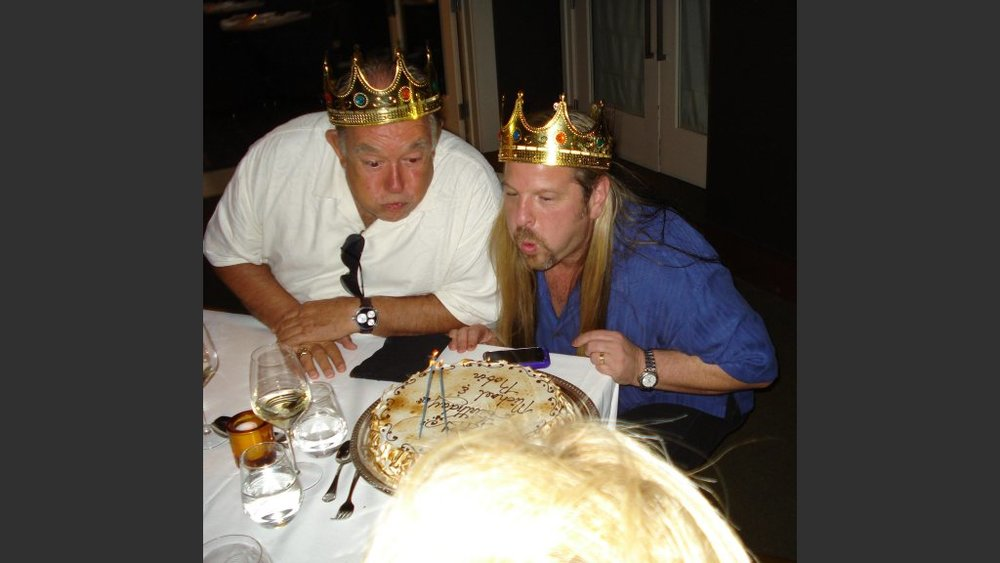 Robin Leach and Michael Boychuck, celebrating a birthday more than a decade ago.