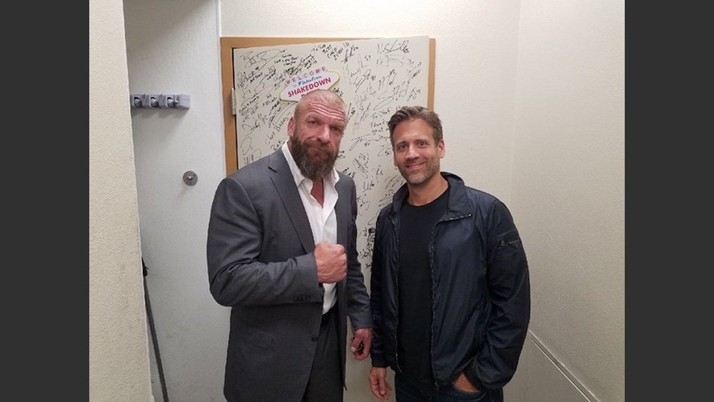 "WWE star Triple H with ESPN personality and boxing analyst Max Kellerman at Scotch 80 Prime, adding their signatures to executive chef Barry Dakake's ""Shakedown Room"" collection. (Courtesy photo)"