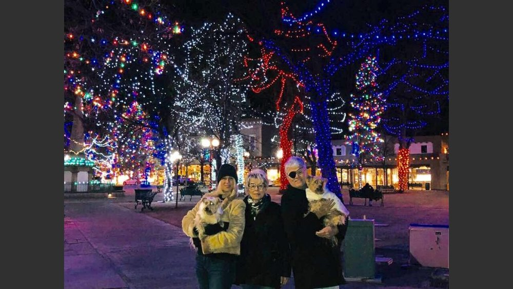 At Santa Fe Plaza with Cara, her mother Jan and the pups, Scandal and Rumor. (Photo retouched by Ken Stewart Photos, Cincinnati)