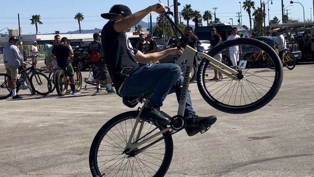 A BMX rider who goes by the Instagram moniker  yooooaydennnn  shows his wheelie skills Saturday after he and about 200 fellow riders rode down Las Vegas Boulevard. Photo: Norm Clarke