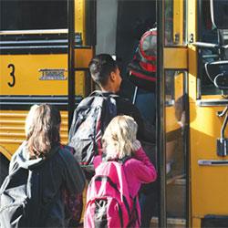 Kids-at-Bus-from-PDF-Postcard-250x250-Web.jpg