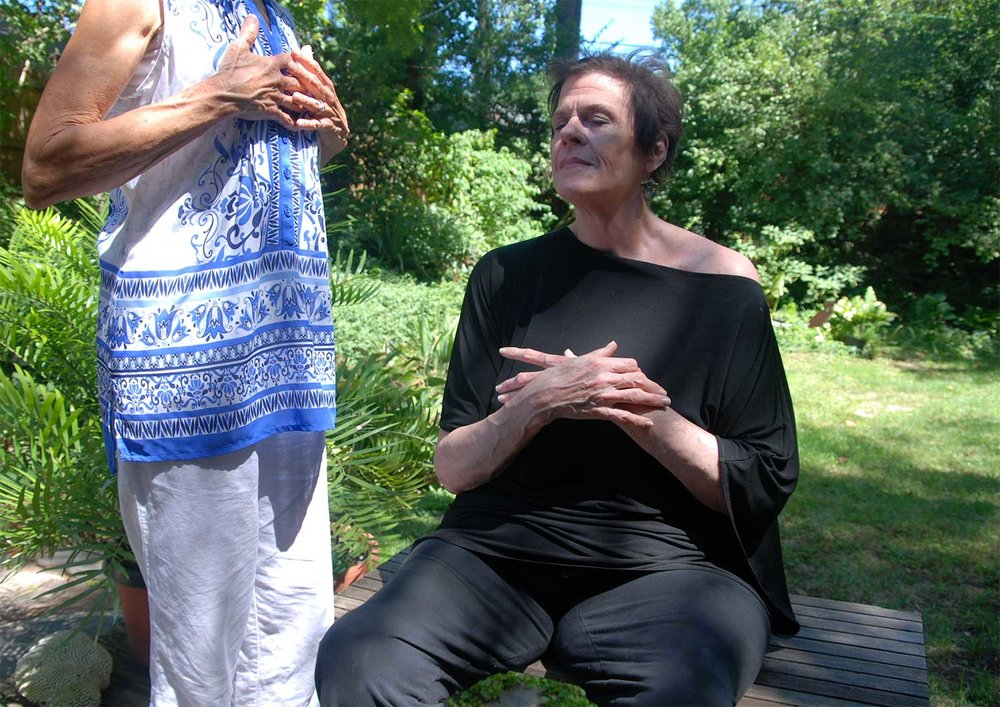 ABOVE: Introducing a client to the complete breath.  BELOW: Gentle adjustments help open heart space and facilitate breathwork.