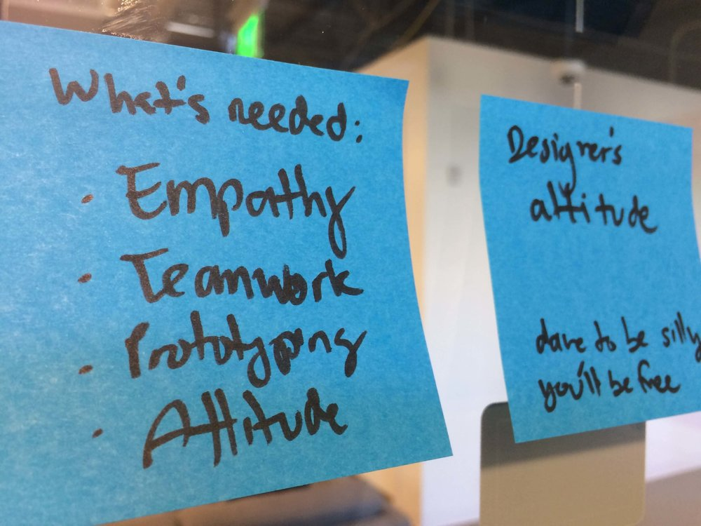 design thinking process post it notes on window