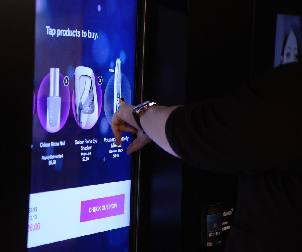 person using a touchscreen kiosk