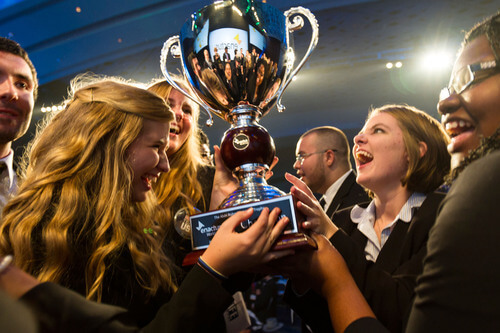 young students and entrepreneurs lifting the trophy of the world cup