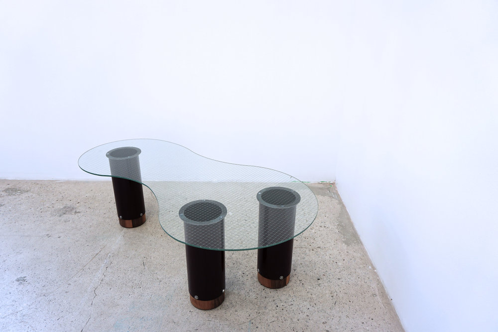 blob table. powder coated steel, stainless steel bolts, wire mesh glass, solid walnut.