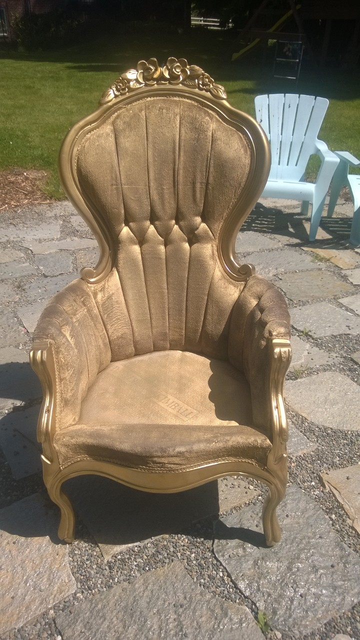 The chair that was spray painted gold before we painted it blue.