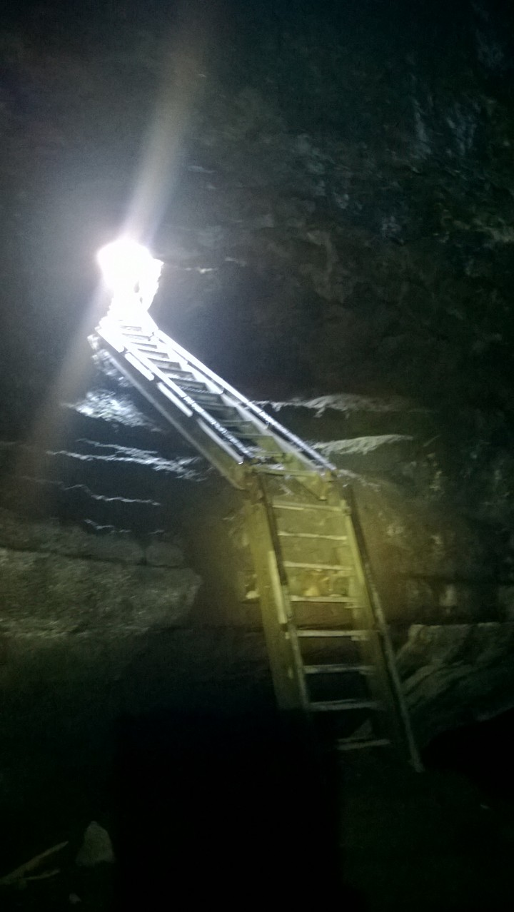 The metal ladder leading up to the exit of the caves.