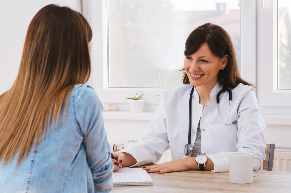 stock-photo-patient-having-consultation-with-female-doctor-in-office-534962014.jpg