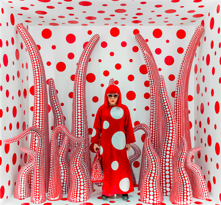 Yayoi Kusama camouflaging herself amoungst her installation