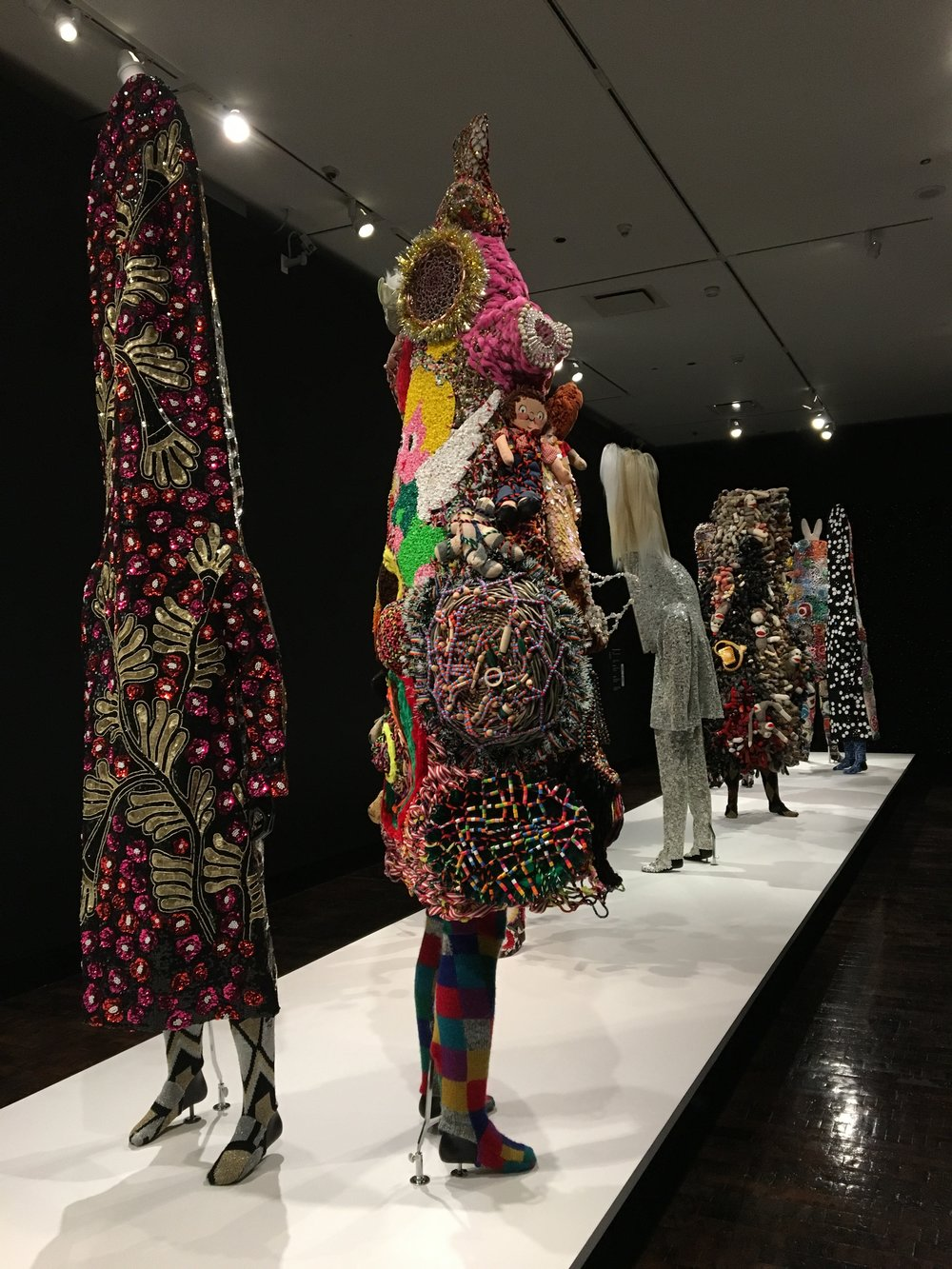 Nick Cave,  Soundsuit , mixed media, all soundsuits on display created between 2010-2017.  Nick Cave,  Architectural Archway (Button Walls) , 2013, mixed media.