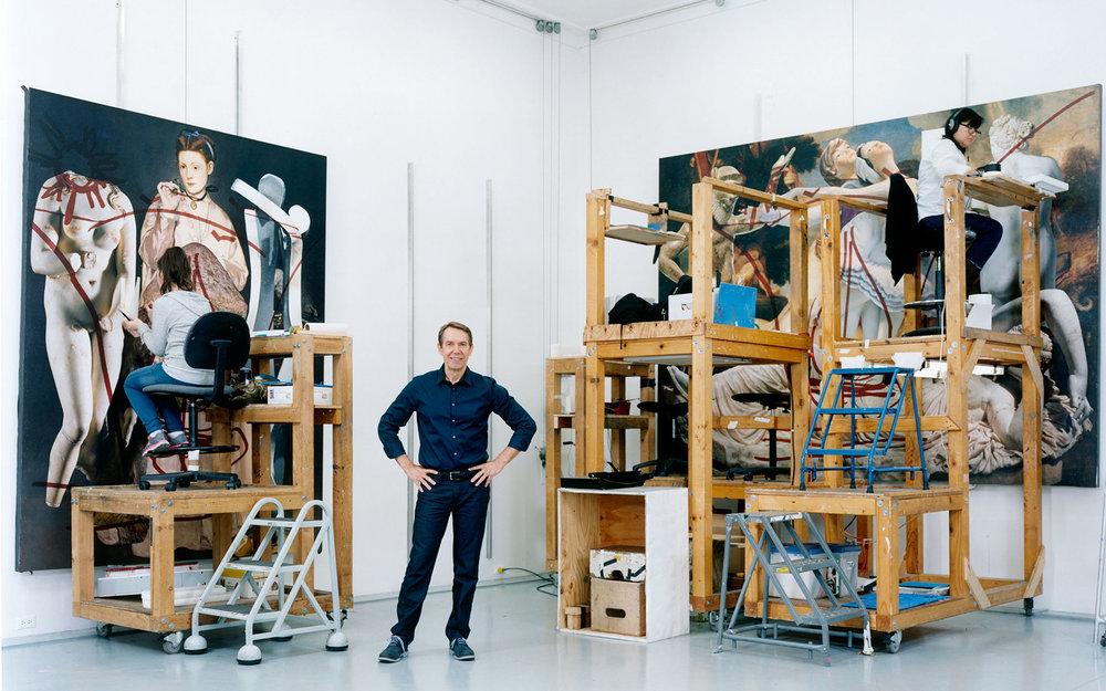 Jeff Koons standing in his studio