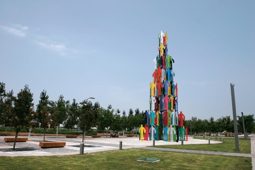 Jonathan Borofsky,  People Tower , 2008, painted steel, 30 meters tall.  Permanent installation at the Olympic Park in Beijing, China. The sculpture is composed of 136 brightly painted interconnecting steel figures, each 2.5m tall. The figures are bolted together to create a 20m tall structure that viewers can walk into and through. Humanity connecting together to build itself.