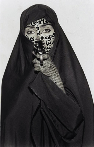 Shirin Neshat,  Faceless , Women of Allah series, 1994, B&W RC print & ink, photo by Cynthia Preston ©Shirin Neshat (courtesy Barbara Gladstone Gallery, New York and Brussel)