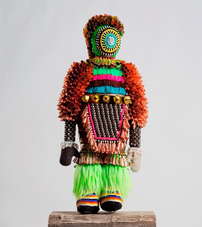 Jeffrey Gibson (Mississippi Band Choctaw/Cherokee),  Like A Hammer , 2014.   Elk hide, glass beads, artificial sinew, wool blanket, metal studs, steel, found pinewood block, and fur; 56 x 24 x 11 in. Collection of Tracy Richelle High and Roman Johnson. Courtesy of Marc Straus Gallery, New York. Image courtesy of Jeffrey Gibson Studio and Roberts Projects, Los Angeles, California. Photograph by Peter Mauney. ©Jeffrey Gibson.
