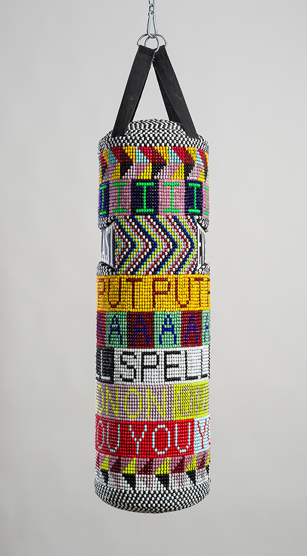 Jeffrey Gibson (Mississippi Band Choctaw/Cherokee),  I PUT A SPELL ON YOU , 2015.   Repurposed punching bag, glass beads, artificial sinew, and steel; 40 × 14 × 14 in (101.6 × 35.6 × 35.6 cm). Collection of the Nasher Museum of Art at Duke University, Durham, North Carolina. Museum purchase, 2015.11.1. Image courtesy of Jeffrey Gibson Studio and Roberts Projects, Los Angeles, California. Photograph by Peter Mauney. © Jeffrey Gibson