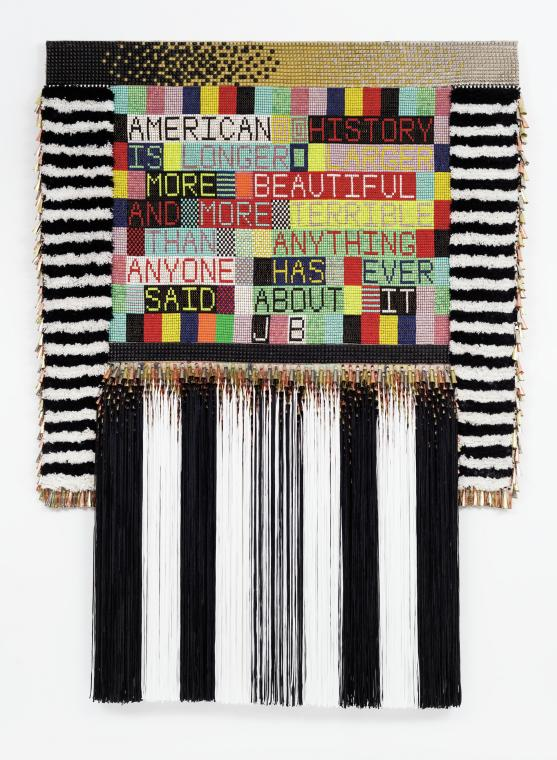 Jeffrey Gibson (Mississippi Band Choctaw/Cherokee),  AMERICAN HISTORY (JB) , 2015.   Wool, steel studs, glass beads, artificial sinew, metal jingles, acrylic yarn, nylon fringe, and canvas; 89 × 66 × 5 in. Lent by the Lewis Family. Image courtesy of Jeffrey Gibson Studio and Roberts Projects, Los Angeles, California. Photograph by Peter Mauney. © Jeffrey Gibson