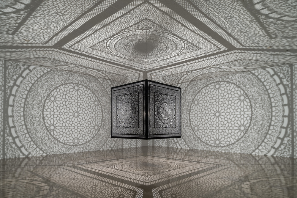 "Anila Quayyum Agha,  Sublime Light , Lacquered Steel and Halogen Bulb, 60"" x 60"" x 60"", 2015. Photo taken while installed at Rice University"