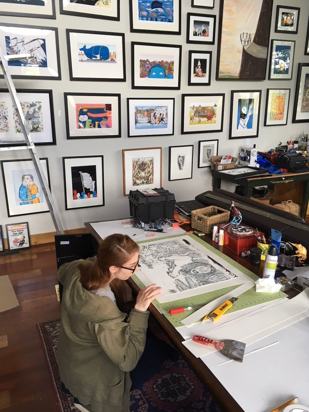 "Eleanor Early, who'll be starting at SVA in the fall, framing an original. This is a brush & ink drawing that will later have color added on the Mac. I'm including both the drawing and the color print to show the process. Art from ""What Little Boys are Made of"" Balzer & Bray, an imprint of Harper Collins, 2012."