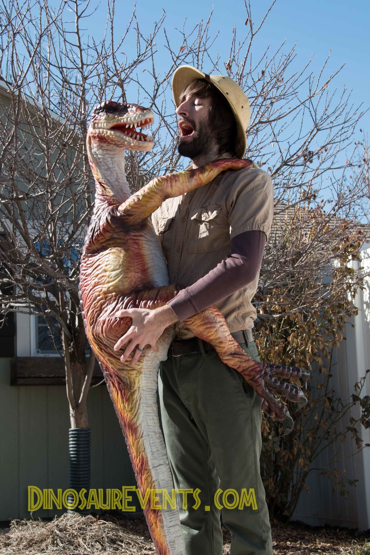 Handheld dinosaur puppet