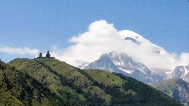 Kazbegi peak and Gergeti Church as viewed from the town.