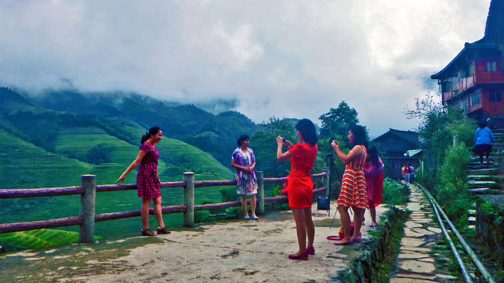 Photo taking sessions happening in the Longji Rice Terracces.