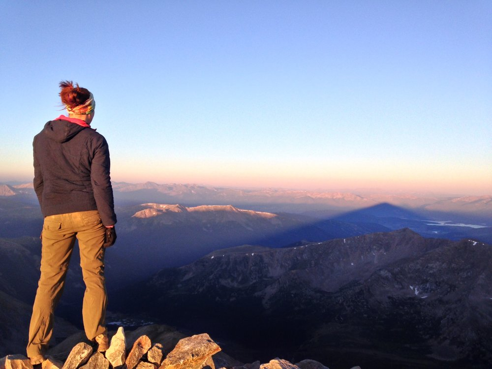 I love to watch the giant shadow of the mountain you're standing on shrink as the sun rises. Summit of Torreys Peak (14,275')