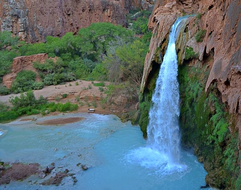 Havasu Falls, Arizona: A truly amazing place on earth where blue water falls over the red limestone cliffs of the Grand Canyon. This was the first adventure my husband and I went on when we were dating.